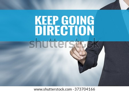 Keep Going direction word on virtual screen touch by business woman cyan sky tab - stock photo