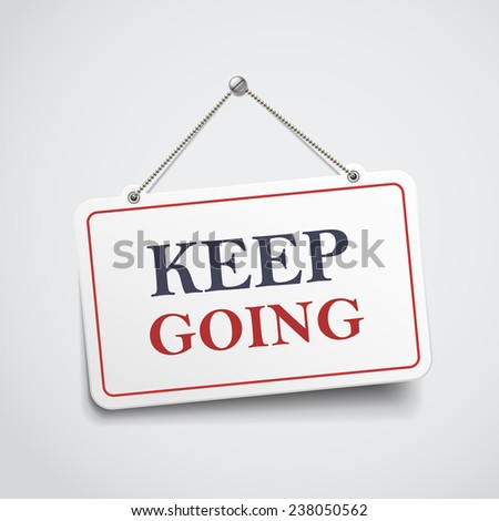 keep going hanging sign isolated on white wall  - stock photo