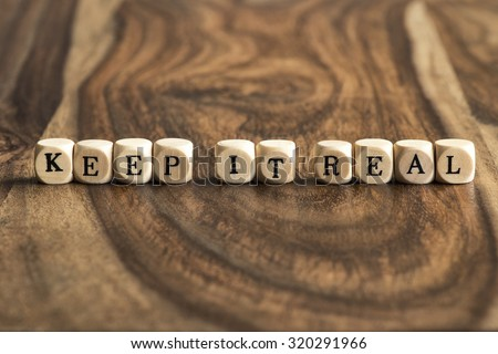 KEEP IT REAL word background on wood blocks - stock photo