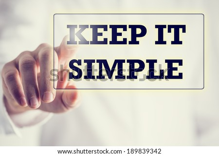 Keep It Simple in a navigation bar on a virtual screen with a businessman touching it to activate it from behind conceptual of simplicity, clarity and easy understanding in business and in life. - stock photo