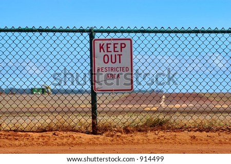 Keep Out - Restricted area sign on a chain linked fence - stock photo