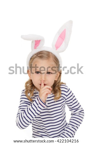 Keep quiet! Studio shot of a little pretty gir wearing bunny ears shushing to the camera seriously isolated on white - stock photo