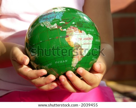 Keep the world for future generation -- Little girl holding a green globe - stock photo