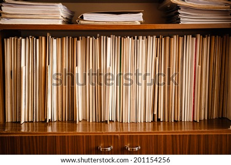 Keeping Paper Records On Shelves Background - stock photo