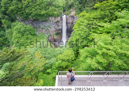 Kegon Falls in Nikko with blurred tourist, One of the top 3 waterfalls in Japan, wide angle view - stock photo