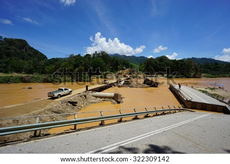KELANTAN, MALAYSIA - MAY 1, 2015 : A view of Jambatan Sungai Setar at Kota Baru, Malaysia, that collapses after the heavy flooded happen on December 2014.