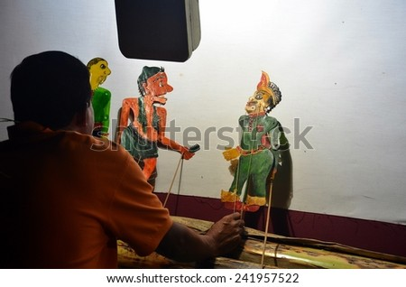 KELANTAN, MALAYSIA - NOVEMBER 18 : The Traditional Malaysian Shadow Puppet Show (Wayang Kulit) by Pak Daim performing during a sahabat media visited November 18, 2014 in Kelantan Malaysia. - stock photo