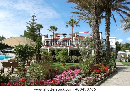 Kemer, ANTALYA, TURKEY- MAY 31, 2015: Palms and flowers near pool in hotel Pirate's Beach Club, Turkey.