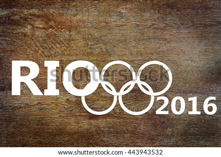 KEMEROVO, RUSSIA - JUNE, 25, 2016. Paper cuttings about Olympic Games in Brazil on wooden background. Abstract conceptual image - stock photo