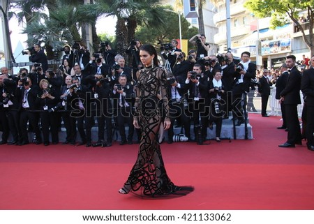 Kendall Jenner attends the screening of 'From The Land Of The Moon (Mal De Pierres)' at the annual 69th Cannes Film Festival at Palais des Festivals on May 15, 2016 in Cannes, France. - stock photo
