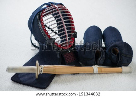 Kendo equipment: men, kote and shinai, studio shot - stock photo