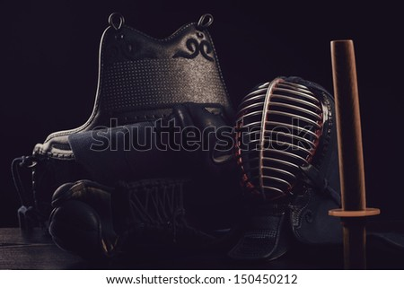 Kendo sports gear, studio shot: men, kote, do and bokuto - stock photo