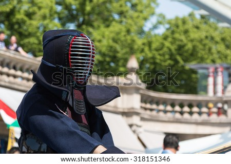 Kendo Warrior with Kendo Uniform and Bamboo Sword. Japanese Martial Art - stock photo