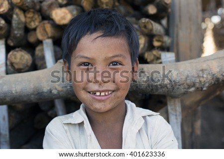 KENGTUNG, MYANMAR - JANUARY 21, 2016: A portrait of a young boy from the Lahu Shi tribe. They are a self sufficient Buddhist tribe who live on the top slope of a mountain and farm their land.