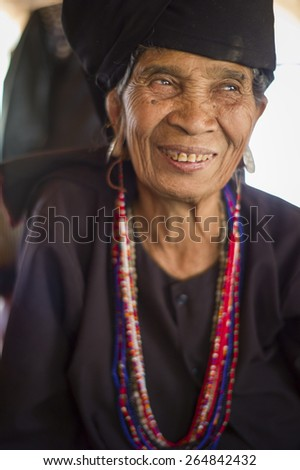Kengtung, Myanmar - MAR 6: The unidentified old lady  in Eng Tribe Villager in Kengtung, Myanmar on March 6 2015. - stock photo