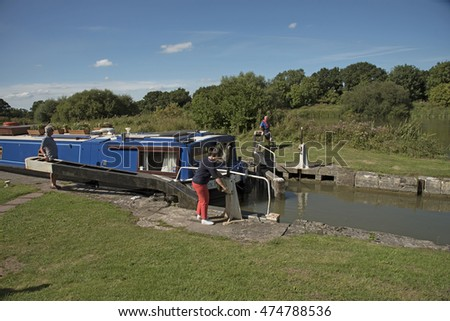 Kennet and Avon Canal Devizes Wiltshire UK - August 2016 -  Canal users opening a lock on the Caen Hill flight at Devizes UK