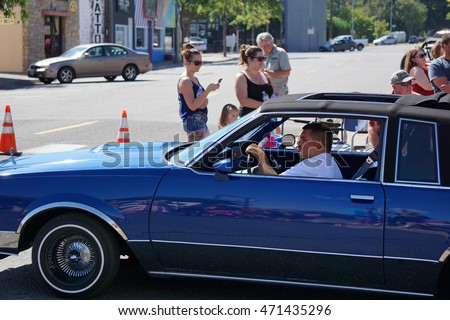 KENNEWICK, WA - AUGUST 20, 2016: Lowrider cars participate in the the Benton Franklin County Fair parade downtown Kennewick