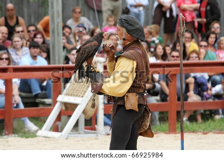 KENOSHA, WI - SEPTEMBER 4: Trainer dressed in medieval costume demonstrates hawks abilities at the annual Bristol Renaissance Faire on September 4, 2010 in Kenosha, WI