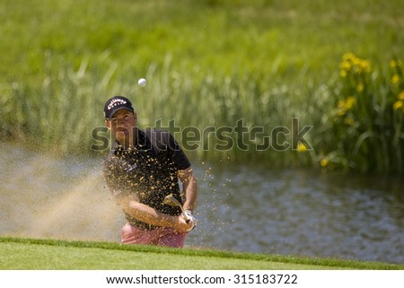 KENT ENGLAND, 29 MAY 2009. Graeme MCDOWELL (GBR) playing a shot from the bunker on the 3rd green during the second round of the European Tour European Open golf tournament.  - stock photo