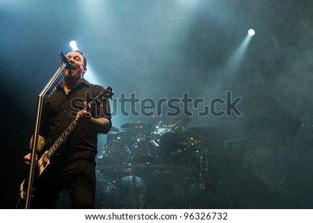 KENT, WA - FEB 21:  Singer and guitar player Michael Poulsen of Danish Heavy Metal rock band Volbeat performs on stage during the Gigantour tour on February 21, 2012  in Kent, Washington. - stock photo