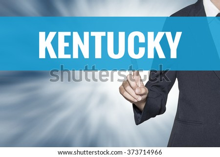 Kentucky word on virtual screen touch by business woman cyan sky tab - stock photo