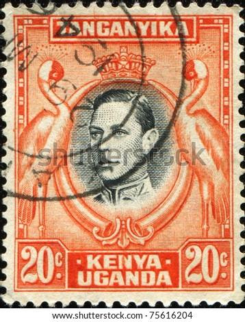 KENYA, UGANDA AND TANGANYIKA - CIRCA 1951: A stamp printed in East Africa shows  medallion portrait of King George V, surrounded of storks, circa 1951 - stock photo