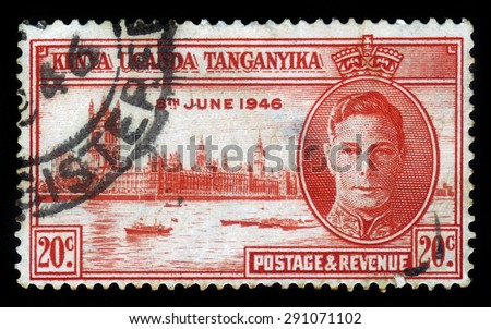 Kenya Uganda Tanganyika - CIRCA 1946: a stamp printed in United Kingdom shows King George VI and Parliament in London , circa 1946 - stock photo