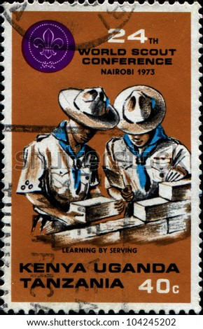 KENYA, UGANDA ,TANZANIA - CIRCA 1973: British stamp valid in Kenya, Uganda and Tanzania dedicated World Scouts Conference, Nairobi, shows two scouts, circa 1973 - stock photo