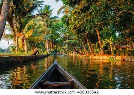 Kerala backwaters tourism travel in canoe boat. Kerala, India - stock photo