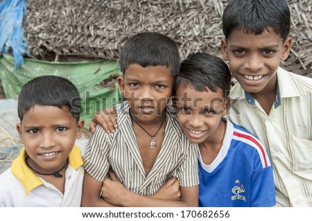 KERALA, INDIA - NOVEMBER 26 , 2011: Unidentified Indian boys sit for their portrait on November 26, 2011 in Kerala, India.