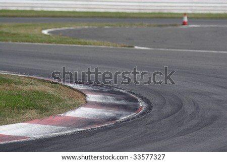 Kerbs at a motor sport circuit with heavy rubber scuffing from racing tires. - stock photo