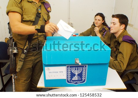 KEREM SHALOM - MAR 27:IDF soldiers votes on March 2006 at Kerem Shalom on March 27 2006.The Israeli Army votes a day before the rest of the citizens of Israel to enable to protect Israel on voting day - stock photo