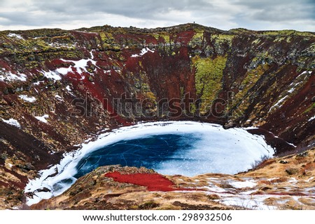 Kerid (or Kerith) volcanic crater lake on the touristic golden circle route in Iceland in winter - stock photo
