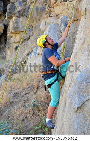 KERN COUNTY, CA-MAY 31, 2014: Isabel Pomgran is one of several teenage students from Olive Knolls Christian School who are building confidence by getting climbing instruction today.