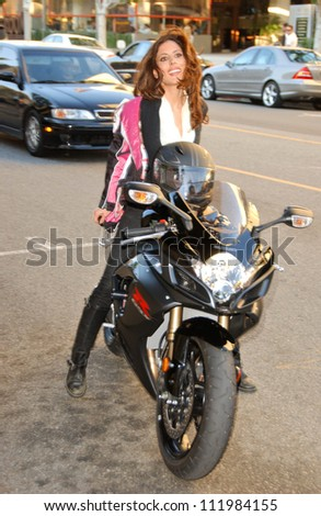 Kerri Kasem arrives on her Suzuki GSXR 750 arriving at the Ivy for lunch, Beverly Hills, CA 02-24-05