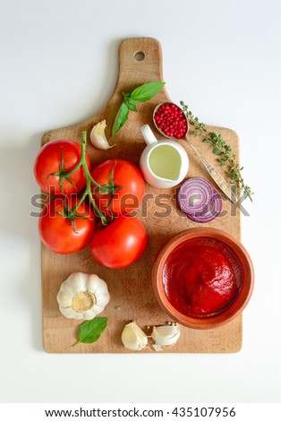 Ketchup or tomato sauce ingredients on a cooking board, concept background - stock photo