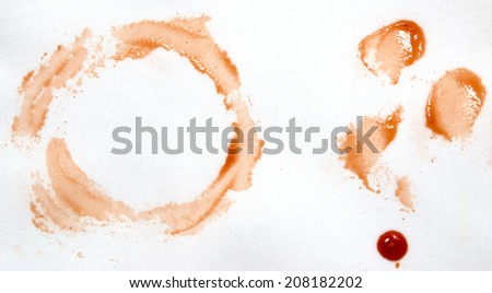 ketchup stains on white cloth - stock photo