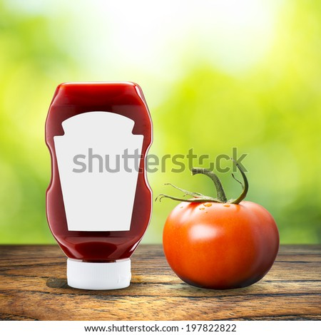 Ketchup with tomato on table with summer scene background - stock photo