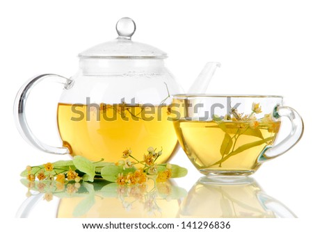 Kettle and cup of tea with linden on  wooden table nature background - stock photo