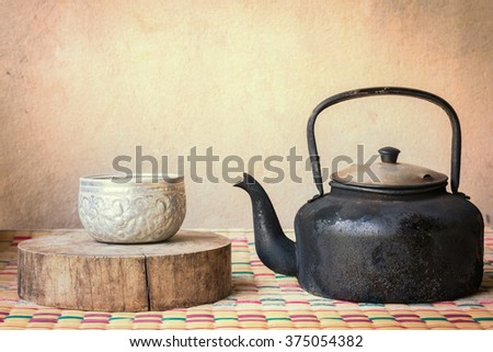 Kettle for boiling hot water to maker hot drink with old style cup of countryside Thailand. - stock photo