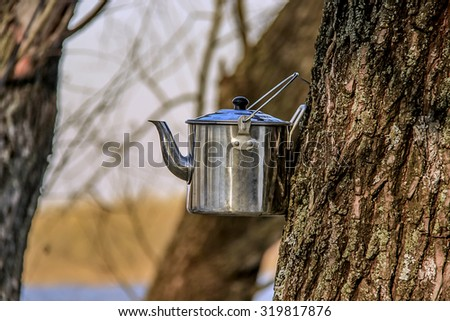 Kettle for tea camping cool down in the open air - stock photo