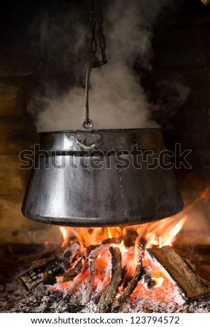 Kettle of fish stew, outdoor cooking - stock photo