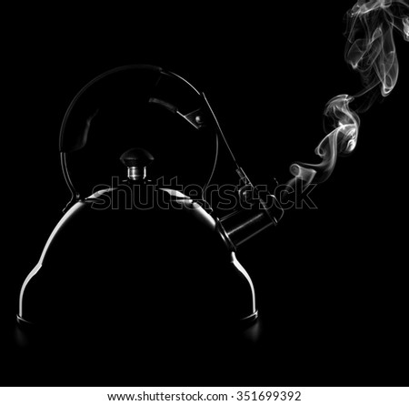 Kettle on a black background - stock photo