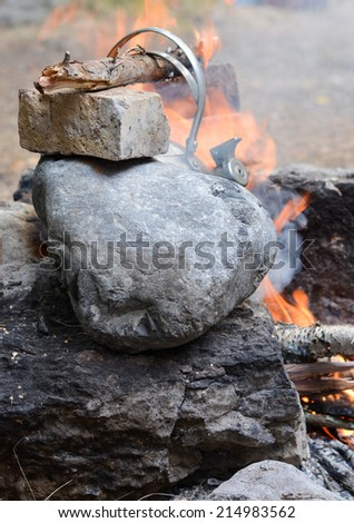 Kettle on the fire - stock photo