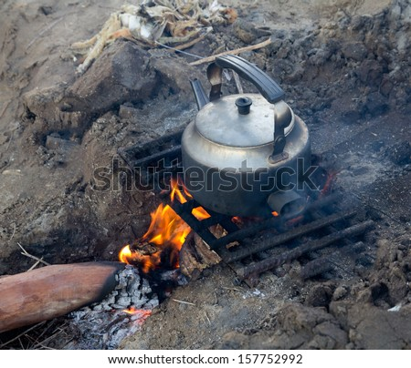 kettle on the nature - stock photo