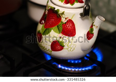 kettle on the stove - stock photo