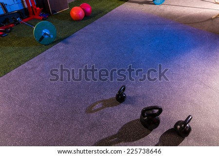 Kettlebells and Barbells in a gym at cross fit - stock photo