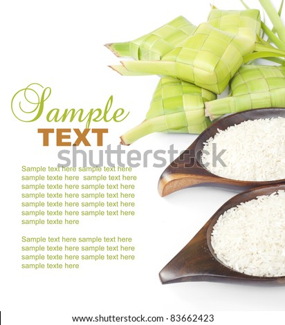 Ketupat and rice on white background. Ketupat is traditional food in Malaysia for Eid Al Mubarak - stock photo