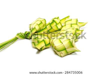 Ketupat on white background. Ketupat is traditional food in Malaysia - stock photo