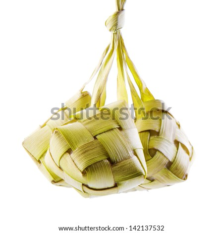 Ketupat or packed rice dumpling. Traditional Malay ramadan food. Popular Malaysian food isolated on white background. - stock photo